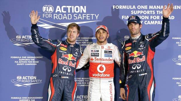 Pole position man Lewis Hamilton flanked by Mark Webber (right), of Australia, and Germany's Sebastian Vettel, yesterday.