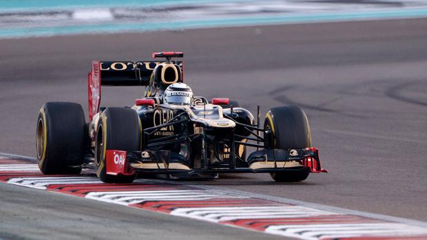 Kimi Raikkonen driving his Lotus at the Yas Marina circuit, yesterday.
