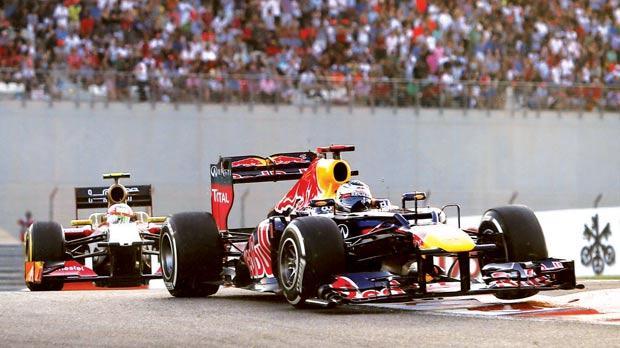 Sebastian Vettel driving his Red Bull at the Yas Marina circuit on Sunday.
