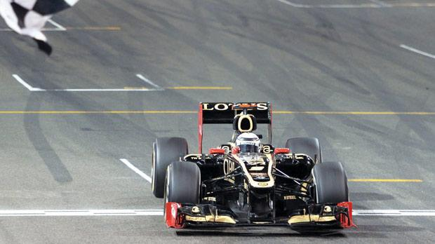Kimi Raikkonen, of Lotus, gets the chequered flag at Yas Marina.