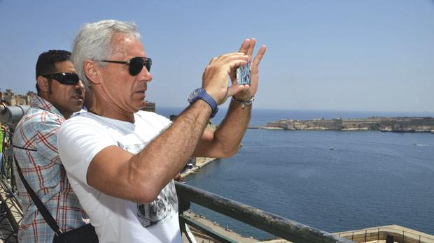 Giuseppe Baresi takes a picture of the Grand Harbour from the Upper Barrakka Gardens. Photo: Charles Vassallo