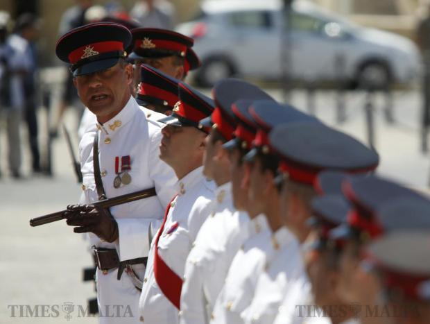 An Armed Forces of Malta parade sergeant-major checks his soldiers are perfectly lined up as they form a guard of honour to welcome Prime Minister Milo Djukanovic of Montenegro outside the office of Prime Minister Joseph Muscat at Castille Place in Valletta on May 18. Photo: Darrin Zammit Lupi