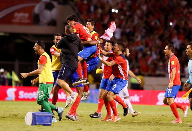 Costa Rica players celebrate after the game after qualifying for the 2018 World Cup.