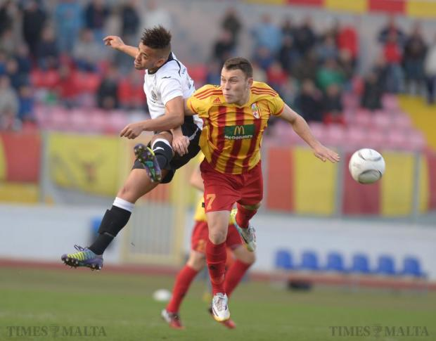 Birkirkara's Ryan Camenzuli (right) and Hibernians' Luis Edison fight for the ball during their Premier League match at the National Stadium in Ta'Qali on January 24. Photo: Matthew Mirabelli