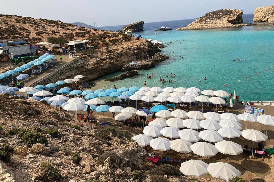 Umbrellas set up by operators in Comino hog the available space by the water's edge. Photo: Karl Andrew Micallef