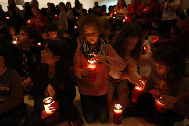 St Michael's Junior School in Pembroke organised a candlelight vigil on November 18 in solidarity with all the children suffering in war-torn countries. The students prepared touching messages against racism and war. Photo: Darrin Zammit Lupi