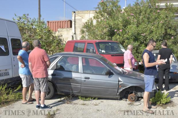 People look at impounded cars during an auction organised by Transport Malta in Pembroke on September 10 Photo: Mark Zammit Cordina