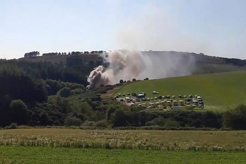 A still image taken from video footage shows smoke billowing from the scene of a train crash near Stonehaven in northeast Scotland.