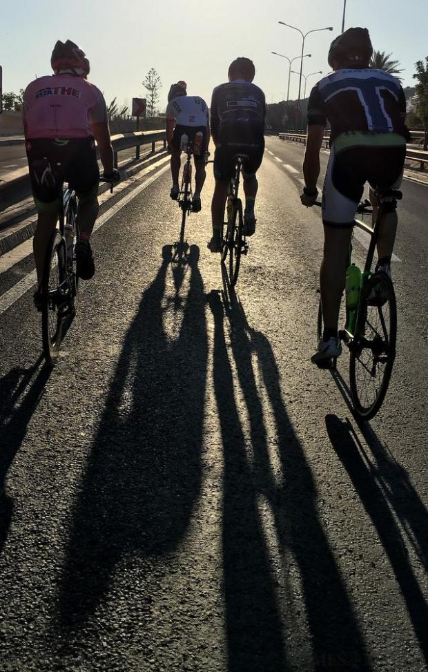 A group of cyclists make the most of the quiet roads on an early morning ride on May 22. Photo: Matthew Mirabelli