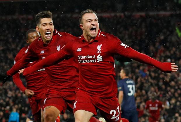 Liverpool's Xherdan Shaqiri celebrates after propelling his team to victory against Man. United.