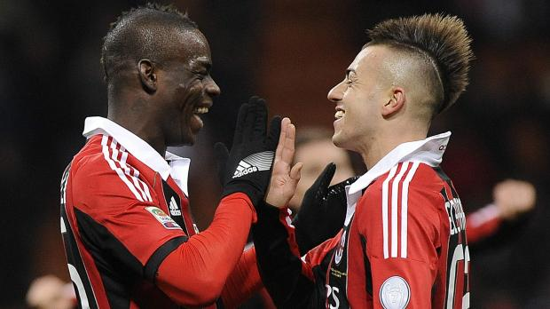 Milan's Mario Balotelli (L) celebrates with his team mate Stephan El Shaarawy after scoring against Udinese during their Italian Serie A soccer match at the San Siro stadium in Milan. Photo: Giorgio Perottino