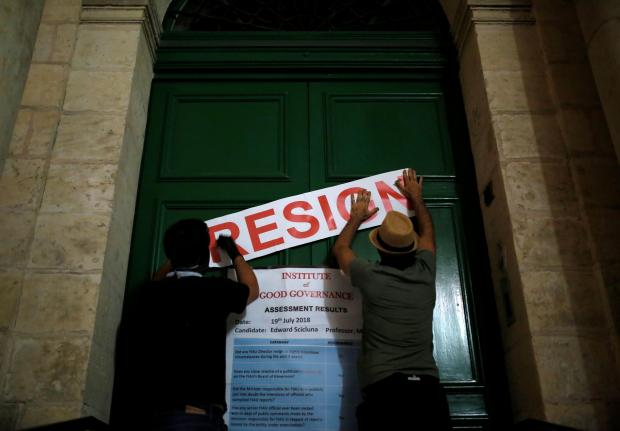 Activist group Resistenza Malta put up a posted on the ministry door called for Scicluna's resignation on Thursday night. Photo: Reuters