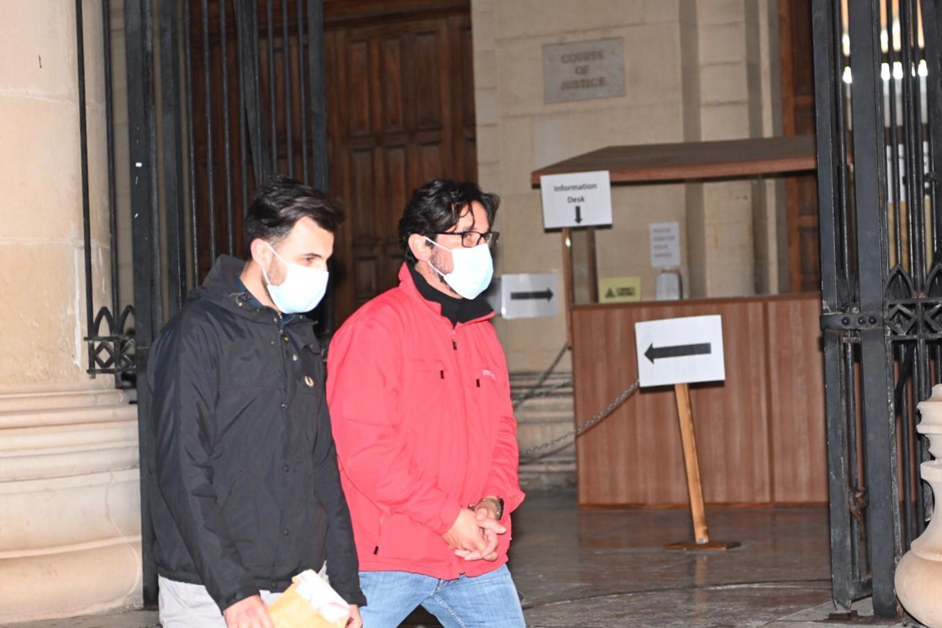 Gordon Debono, right, leaves court after his arraignment. Photo: Mark Zammit Cordina