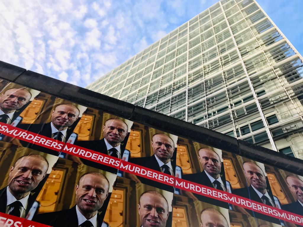 Posters of the Prime Minister with the word 'murderers' have been affixed near the EU institutions in Brussels.
