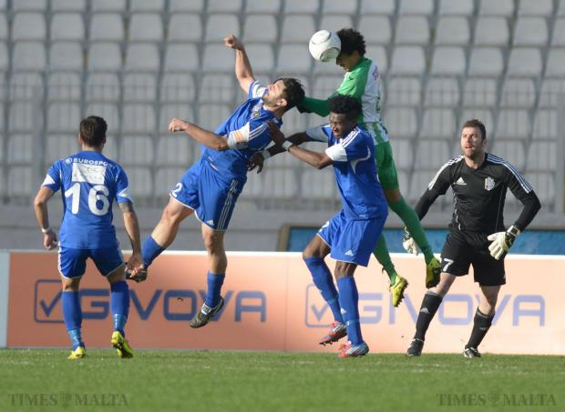 Floriana 's Emerson Marcelina, beats Mosta's Yannik Ossok (right) and Tyron Farrugia (left) to the ball during their Premier League match at the National Stadium in Ta'Qali on January 24. Photo: Matthew Mirabelli