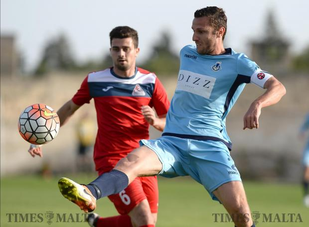 Sliema's Alex Muscat (right), tries to keep control of the ball as Pembroke's Miguel Attard pressures him during their BOV premiership match at the Hibernians Stadium in Kordin on April 29. Photo: Matthew Mirabelli