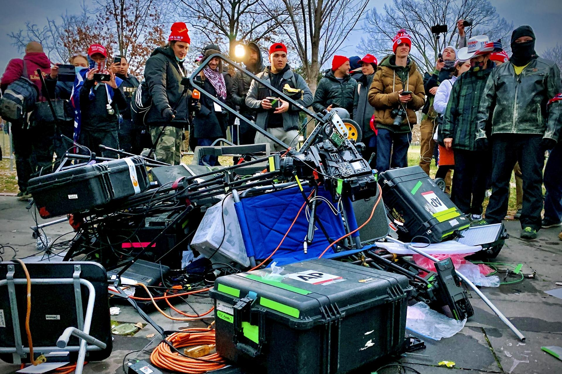 Trump protesters look at media equipment they destroyed during Wednesday's riot.