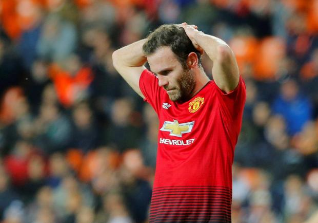 Manchester United's Juan Mata reacts to the loss which keeps them away from the group's top spot.