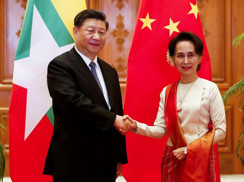 China's president Xi Jinping and Aung San Suu Kyi shake hands in this January 2020 meeting held in Myanmar's capital Naypyidaw. Photo: AFP