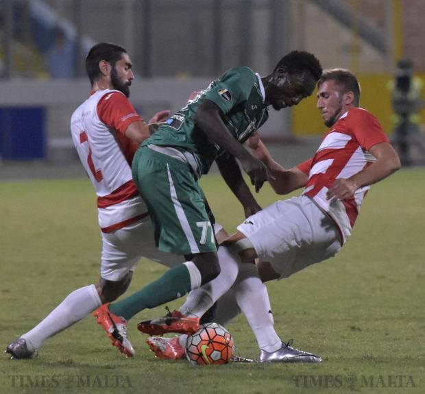 Floriana's Amadou Samb (centre) is blocked by Valletta's Jonathan Caruana (left) and Llywelyn Caruana during their Premier League football match at the National Stadium in Ta' Qali on September 21. Photo: Mark Zammit Cordina