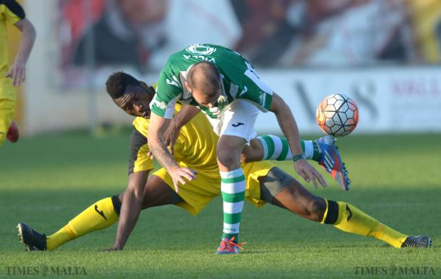 At full stretch... Qormi defender Ousmane Sidibe (left) slides in to dispossess Floriana's Mauricio Villa at Hibernians Stadium on December 6. Photo: Matthew Mirabelli