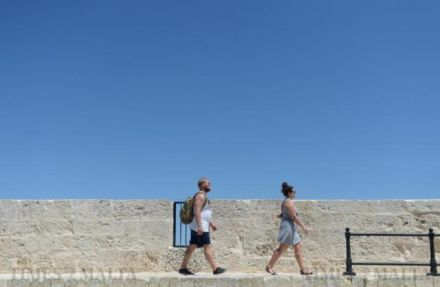 Tourists enjoy the quiet streets of Mdina on a hot summer's day on August 16. Photo: Matthew Mirabelli