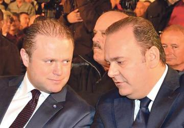 Chris Cardona (right, with the Prime Minister) claimed €2,003 in extra charges on his €8,000 hotel invoice after his visit to Monaco.