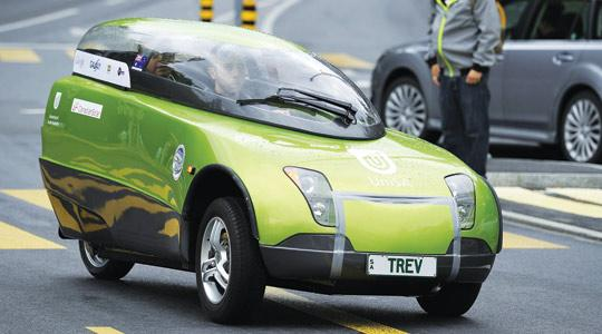 The Team TREV on board an electric Australian-made vehicle leaves the United Nations Offices in Geneva yesterday, at the start of a 80-day round-the-world trip to raise awareness about emissions free transport and the Cancun World climate conference in November. Photo: Fabrice Coffrini/AFP