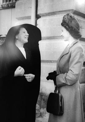 The Princess speaking to a woman dressed in a traditional Maltese headdress (għonella).