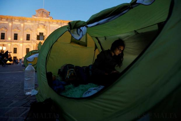 An activist works on a laptop in a tent in a camp set up by environmental activists protesting against what they say is over-development throughout the Maltese islands, in front of the Auberge de Castille housing the Office of the Prime Minister in Valletta on May 14. Photo: Darrin Zammit Lupi