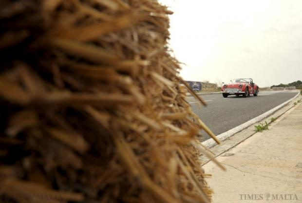 One of the cars participating in the Mdina Grand Prix Classic Car event passes a stack of hay bales during a qualifying lap on October 10. Photo: Matthew Mirabelli