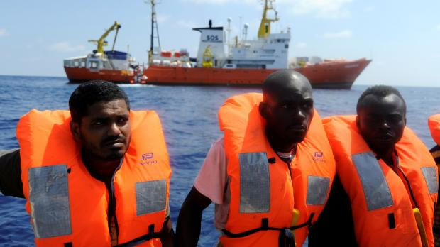 Three men rescued by the Aquarius, which can be seen in the background of this file photo. Photo: Reuters
