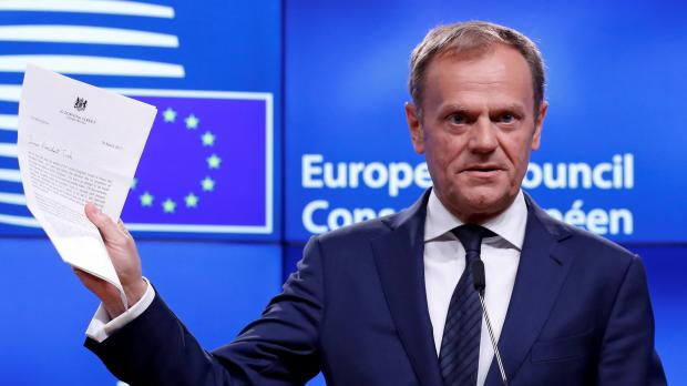 European Union offers pre-Brexit trade talks, tough on transition