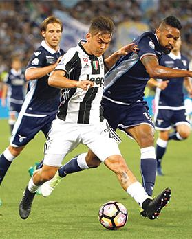 Juventus striker Paolo Dybala (centre) in action during the Coppa Italia final against Lazio, on Wednesday.