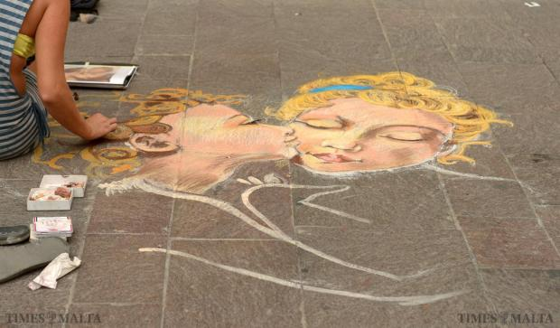 A street artist sketches on the paving outside the law courts in Valletta on September 7. Photo: Matthew Mirabelli