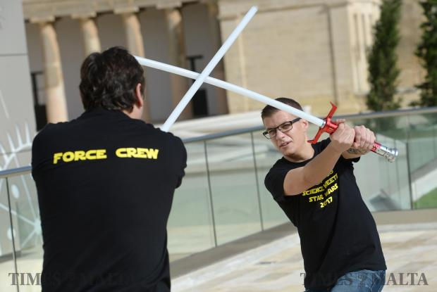 Two Star Wars enthusiasts display their light saber skills during a Star Wars exhibition at Esplora Interactive Science Centre at Bighi on November 12. Photo: Matthew Mirabelli