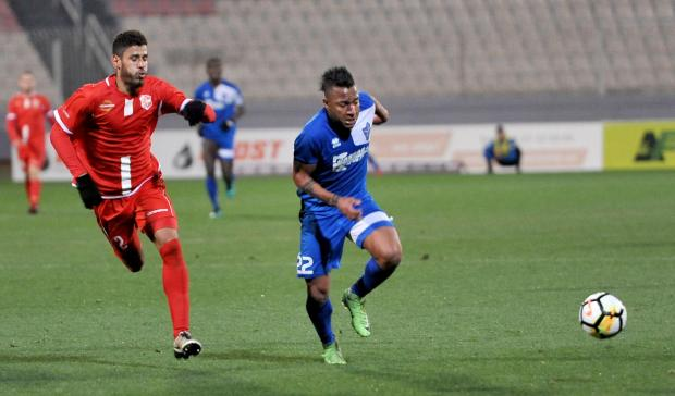 Man of the match Ricardo Faria (left) in action for Tarxien Rainbows against Naxxar Lions. Photo: Chris Sant Fournier