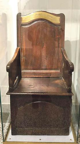 The chair used by De La Salle in his classroom at the same museum.