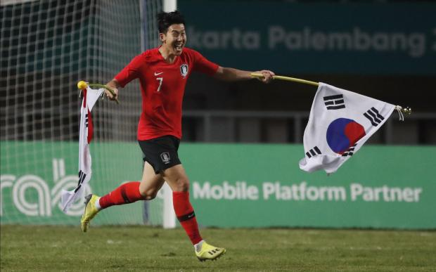 Son Heung Min of South Korea celebrates after winning the gold medal.