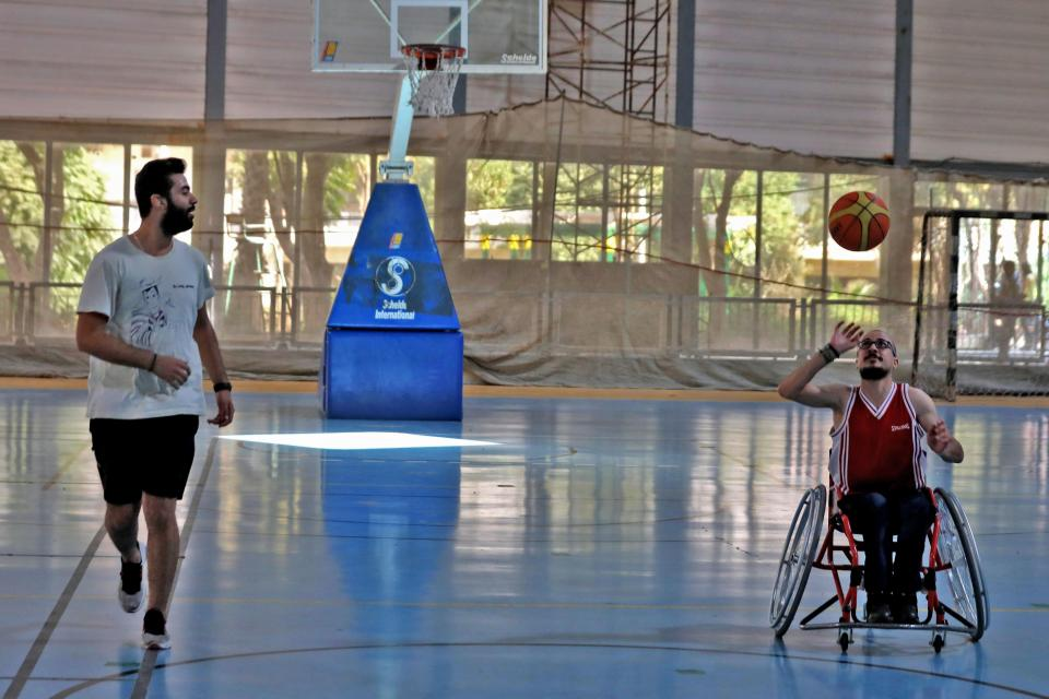 Bader (right) plays basketball with Ahmad.
