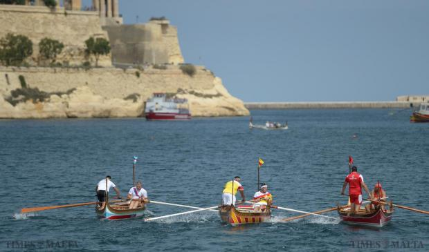 The crews of Birzebugia, (left) Senglea, (centre) and Vittoriosa (right) close in on each other during the opening race of the regatta in the Grand Harbour on September 8. Photo: Matthew Mirabelli