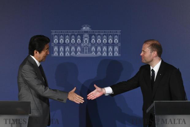 Joseph Muscat greets Prime Minister Shinzō Abe (left) after a press conference in Valletta on May 27. Photo: Jonathan Borg