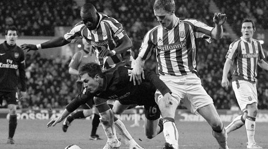 Stoke's Ryan Shawcross (right) challenges Arsenal's Aaron Ramsey at the Brittania Stadium.