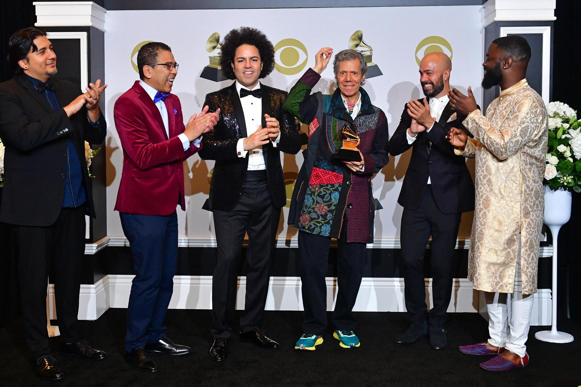 """Chick Corea and The Spanish Heart Band pose in the press room with the award for Best Latin Jazz Album for """"Antidote"""" during the 62nd Annual Grammy Awards on January 26, 2020, in Los Angeles. Photo: Frederic J. Brown/AFP"""