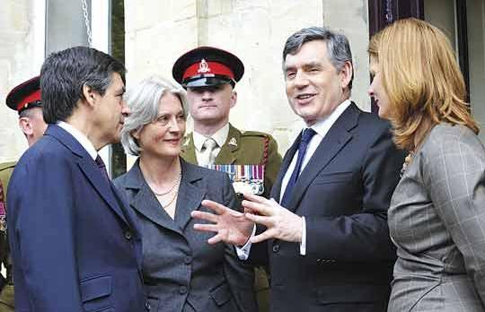 French Prime Minister François Fillon (left) and his wife Penelope Fillon speak with Britain's Prime Minister Gordon Brown and his wife Sarah Brown (right) yesterday at the Bayeux cemetery during the commemorations marking the 65th anniversary of the June 6, 1944 allied landings in Normandy, northwestern France. (AFP)
