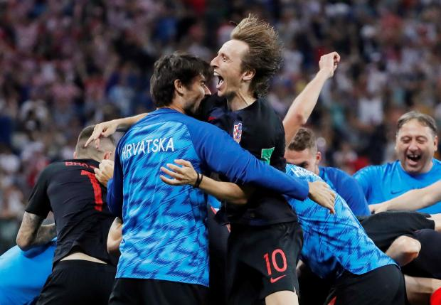 Luka Modric (centre) celebrates Croatia's qualification to the quarter-finals.