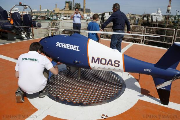 A Migrant Offshore Aid Station (MOAS) crew member looks at a Schiebel Camcopter S-100 drone on board the ship MV Phoenix in Marsa on May 2. The 40-metre ship MV Phoenix, manned by personnel from international non-governmental organisations Medecins san Frontiere (MSF) and MOAS, left Malta for a six-month mission to search for and rescue migrants in the Mediterranean. The Phoenix is the first privately funded vessel to operate in the Mediterranean. Photo: Darrin Zammit Lupi