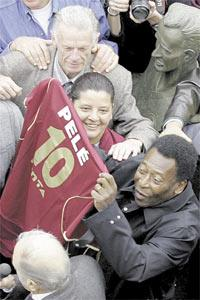 Soccer legend Pele holds a jersey of Brazilian soccer club Juventus after the unveiling of a bust in Sao Paulo. The bust was commissioned in tribute to what many consider as Pele`s greatest goal, scored when playing for Santos against Juventus on August 2, 1959.