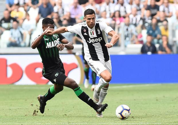 Juventus' Cristiano Ronaldo in action with Sassuolo's Marlon.