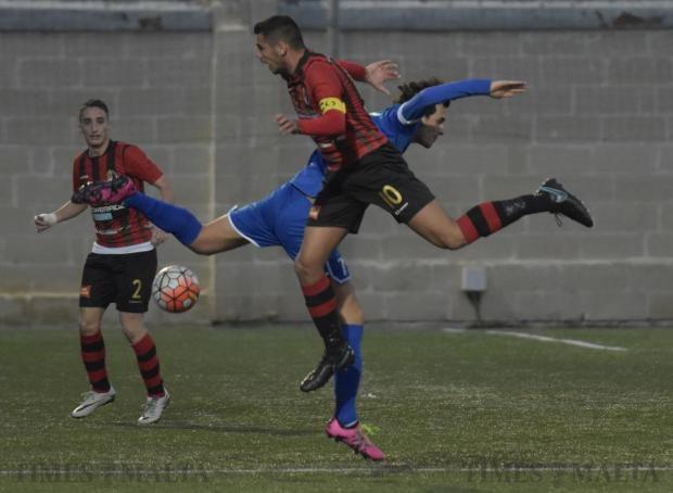 Hamrun Spartans' Jake Grech and Tarxien Rainbows' Triston Caruana tangle for possession during their Premier League football match at the Tedesco Stadium in Hamrun on December 18. Photo: Mark Zammit Cordina